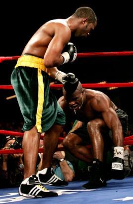 ... gallery Boxer ONeil Bell, left, brings Jean-Marc MORMECK to his knee